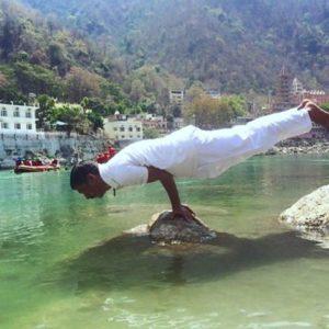yogi narayan bhatt doing yoga at ganga beach