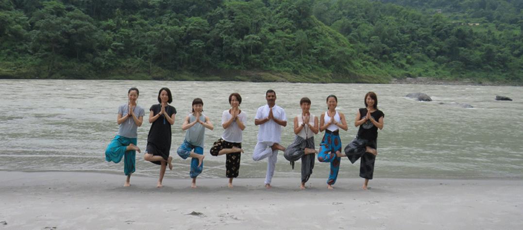 yoga pose at ganga beach at narayan yoga school rishikesh india